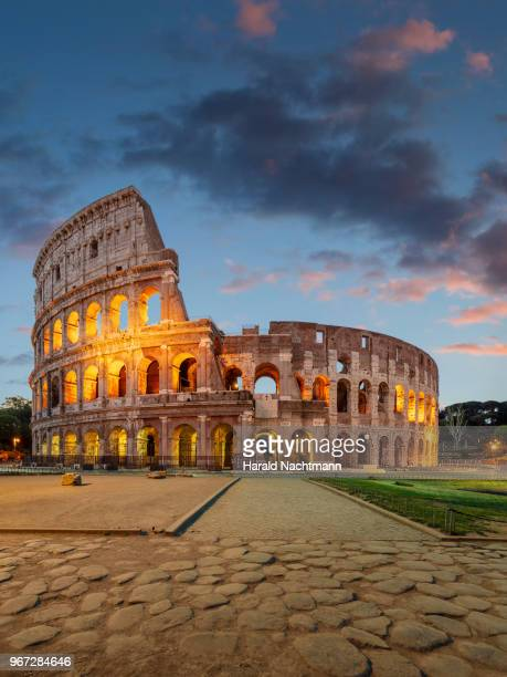 colosseum in the evening - rome italy stock pictures, royalty-free photos & images