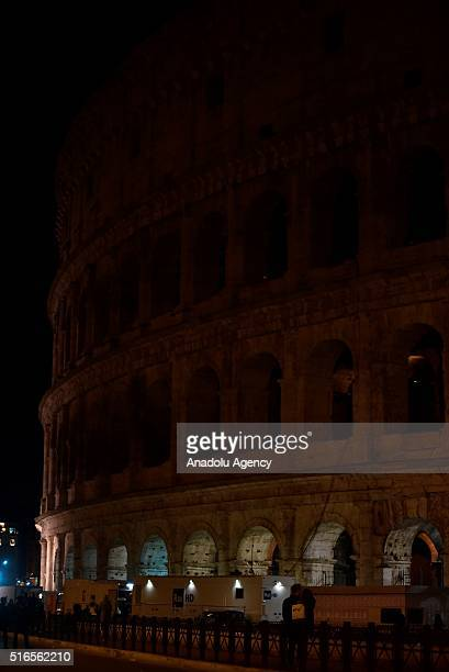 Colosseum is seen after its lights were turned off during the Earth Hour event organized by the World Wide Fund for Nature to draw attention to...