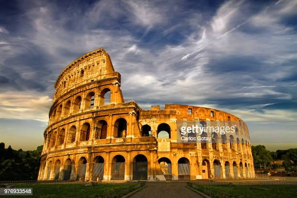 colosseum under cloudy sky, rome, italy - colosseum stock pictures, royalty-free photos & images