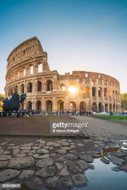 Colosseum with the sun through the arches. Rome, Lazio, Italy.