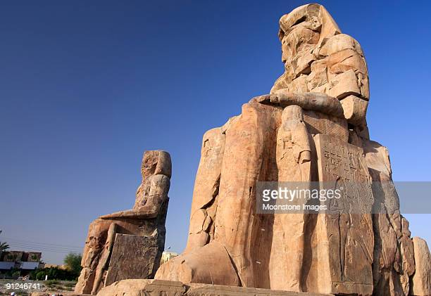 colossi of memnon in luxor, egypt - colossus stock photos and pictures