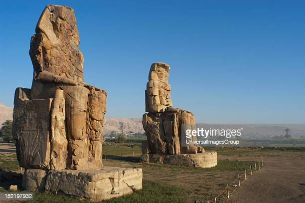 Colossi of Memnon Stone statues depicting pharaoh Amenhotep III in a seated position Panoramic view Eighteenth Dynasty New Kingdom Luxor Egypt