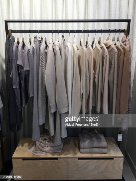 colour coordinated clothes rail 2 - cashmere stock pictures, royalty-free photos & images