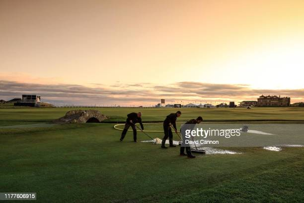 Colour graduated filter used: Greens keepers clear the standing water on the 18th hole left from the overnight rain during the third round of the...