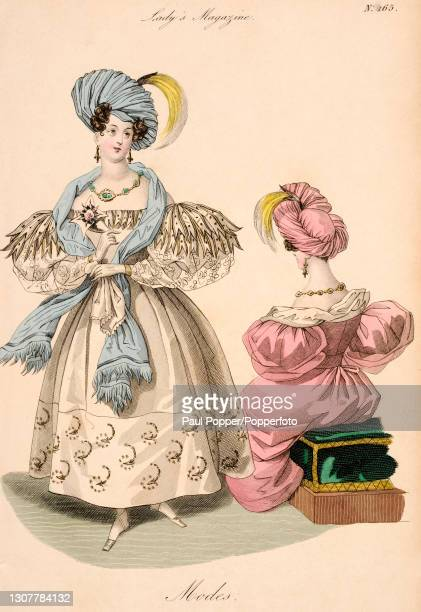 Colour illustration from The Royal Ladies Magazine showing two women wearing French fashions, one wears an embroidered white silk and gauze dress,...