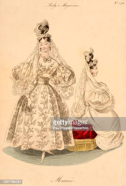 Colour illustration from The Royal Ladies Magazine showing two women wearing French fashions, one wears a white muslin and lace wedding gown with all...