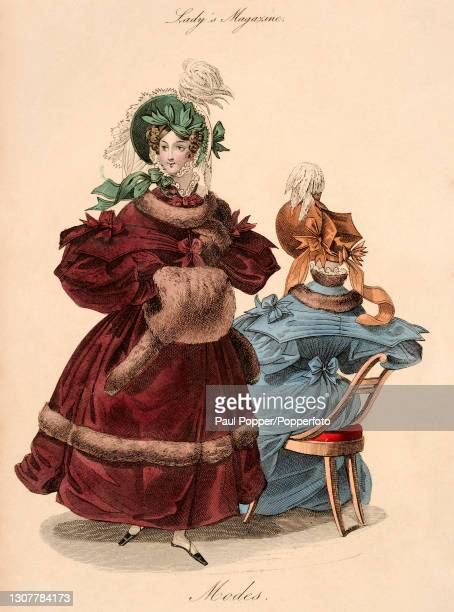 Colour illustration from The Royal Ladies Magazine showing two women wearing French fashions, one wears a burgundy satin coat with leg of mutton...