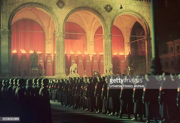 Colour image shows the gathering of the annual midnight swearingin of Nazi SS troops Every year the Nazi troops would have to swear an oath of...