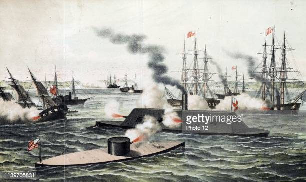 Colour lithograph print shows the Monitor and the Merrimack firing at each other during battle, with other battleships in the background, one sinking...