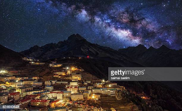 Colour night of the Sherpa village Namche Bazar with milky way over the mountain - Nepal Himalaya