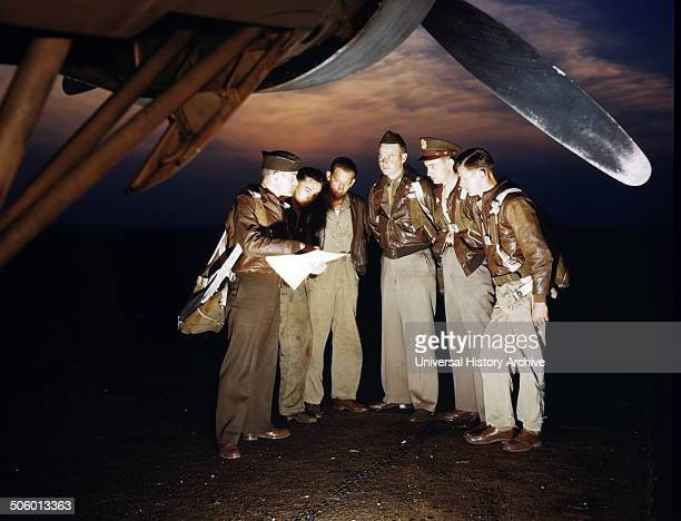 Colour photograph of a combat crew receiving their final instructions before taking off in a YB17 bomber Langley Field Virginia Dated 1942 Photo by