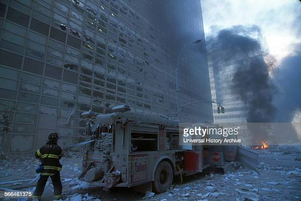 Colour photograph of a New York Firefighter amid the rubble of the World Trade Centre following the 9/11 attacks Dated 2001