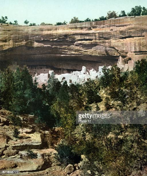 Colour photograph of Cliff Palace. The largest cliff dwelling in North America. The structure built by the Ancestral Puebloans is located in Mesa...