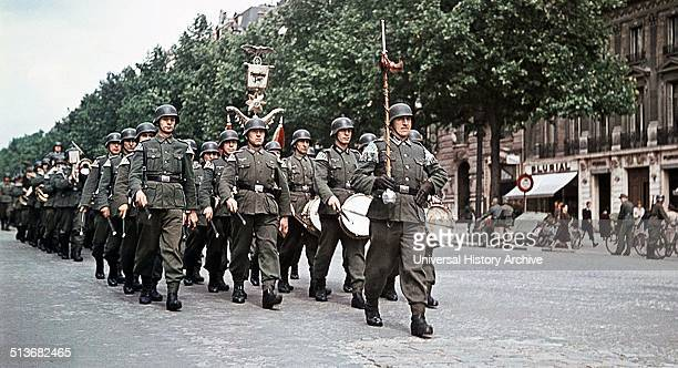 Colour photograph of German troops marching through occupied Paris Dated 1940