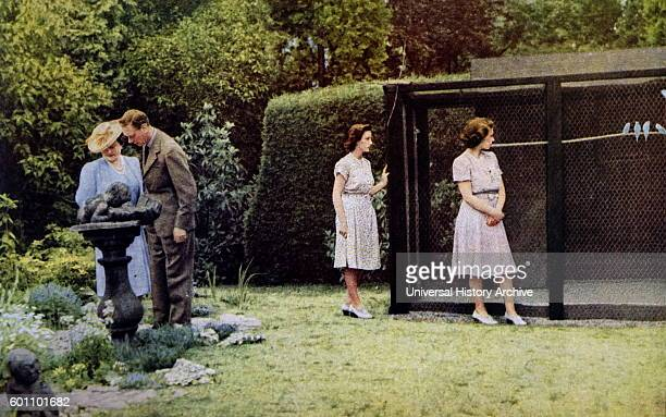 Colour photograph of King George VI the Queen Mother Queen Elizabeth II and Princess Margaret in the gardens of Windsor Castle Dated 20th Century