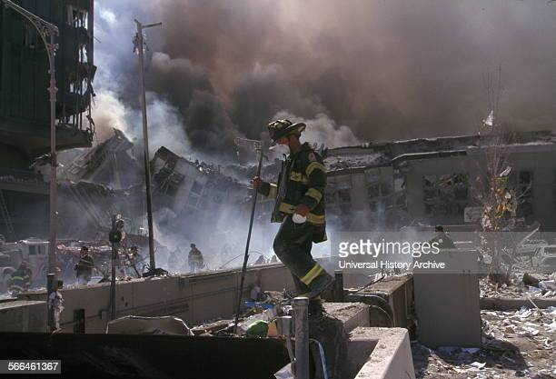 Colour photograph of New York Firefighters amid the rubble of the World Trade Centre following the 9/11 attacks Dated 2001