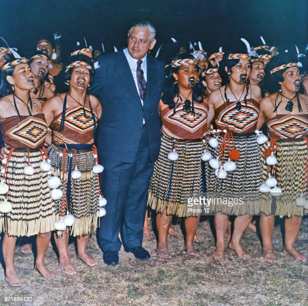Colour photograph of Rt Hon Norman Kirk Prime Minister of New Zealand with a Maori Cultural Group Dated 1975