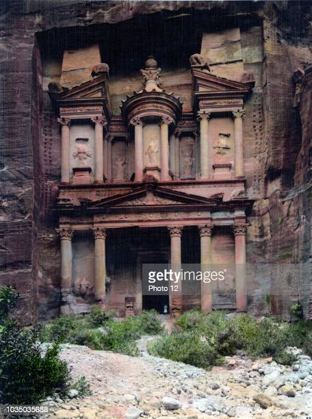 Colour photograph of the Temple of El-Khazneh within the ruined city of Petra in Jordan. Dated 1950.