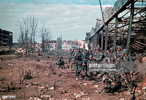 Colour photograph showing German forces in a assault on a warehouse in Stalingrad during World War Two. Dated 1942.