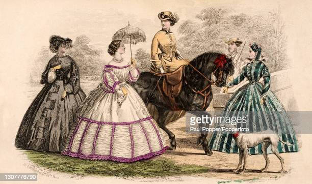 Colour plate from the Englishwoman's Domestic Magazine, showing four women in a country setting, one woman is sitting side saddle on a horse and...