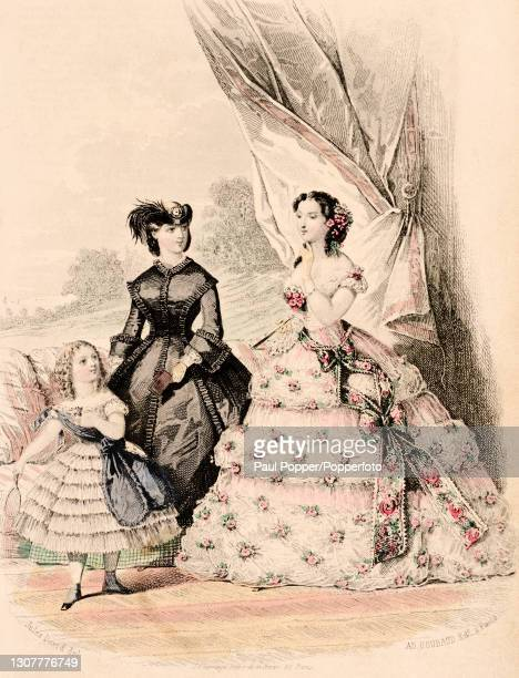 Colour plate from the Englishwoman's Domestic Magazine, showing two women and a child in front of a heavy curtain, one woman wears a fitted black...
