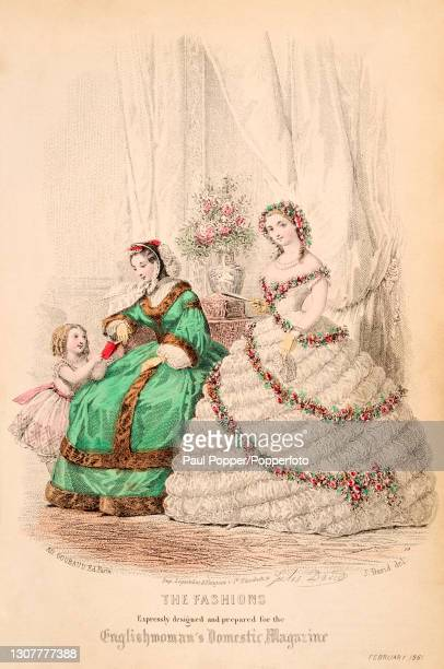 Colour plate from the Englishwoman's Domestic Magazine, showing two women and a child in a drawing room, one wears a white off the shoulder gauze...
