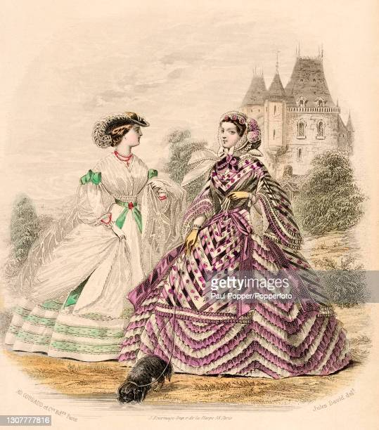 Colour plate from the Englishwoman's Domestic Magazine, showing two women in front of a chateau, one woman wears a purple and white chevron striped...