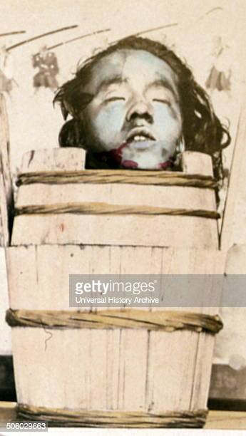 Colour portrait of the head of Hayashida Tciken, a japanese man executed by beheading. Photograph taken by John Thomson . Dated 1890 Photo by: