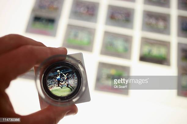 Colour slides of Diego Maradona's infamous 'Hand of God' goal are laid out from the vast collection of historic photographs stored in the Hulton...