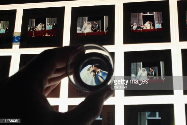 Colour slides of Prince Charles and Princess Diana's wedding kiss are laid out from the vast collection of historic photographs stored in the Hulton...