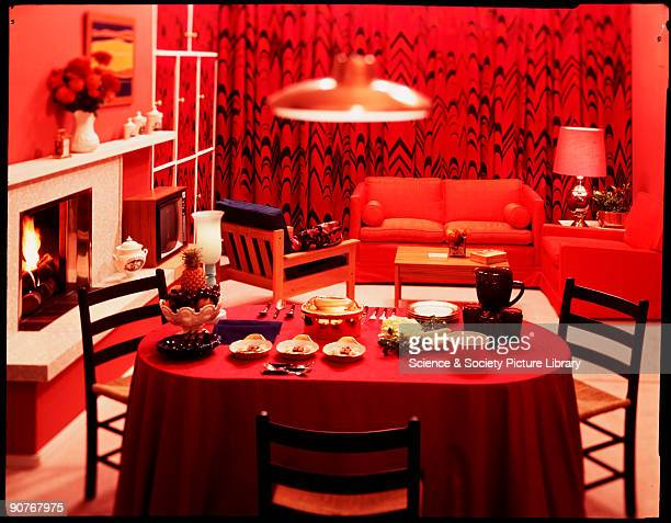 A colour transparency of a boldly decorated dining room taken by Zoltan Glass in about 1960 The intense red of the decor and the style of the...