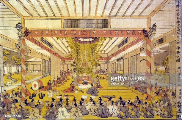 Colour woodcut showing a perspective view in the shrine at Ise with a ceremony taking place before the royal throne. Dated 1769.