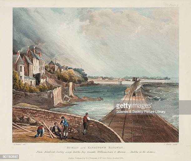 Coloured aquatint looking across Dublin Bay towards Williamstown and Merrion, with Dublin in the distance. A steam locomotive is illustrated heading...