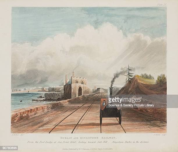 Coloured aquatint showing a locomotive on the Dublin Kingstown Railway The view is looking 'towards Salt Hill with Kingstown Harbor [sic] in the...