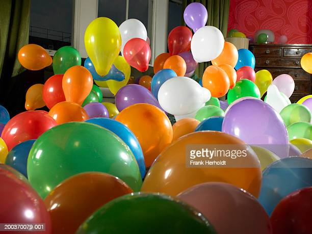 coloured balloons in living room - room after party stock pictures, royalty-free photos & images