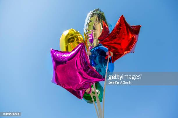 coloured balloons - helium balloon stock pictures, royalty-free photos & images