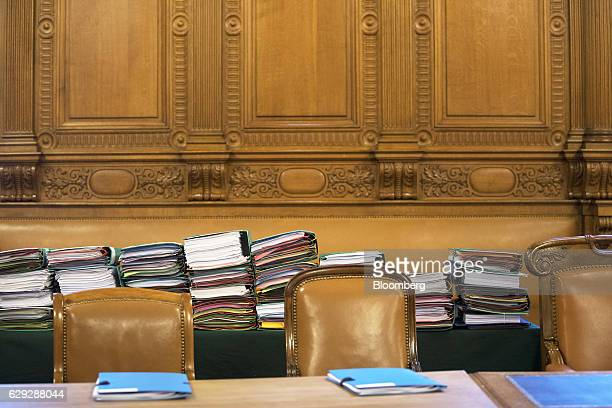 Coloured document folders marked with the name of Christine Lagarde managing director of the International Monetary Fund sit on a desk inside the...