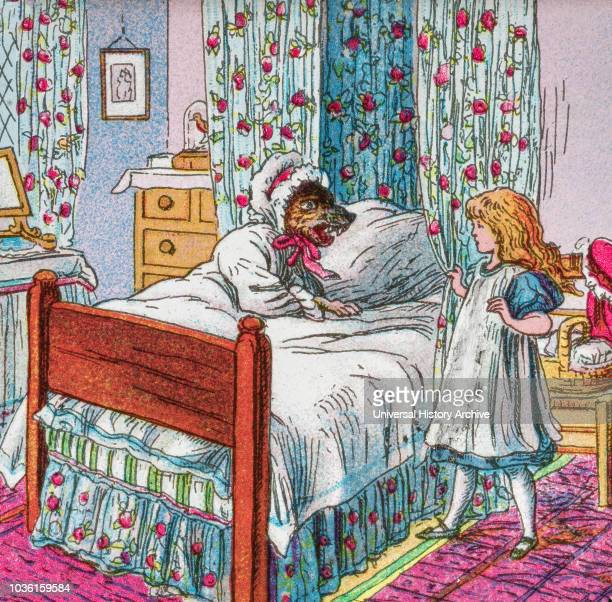 Coloured illustration in a child's storybook Little Red Riding Hood with the big bad wolf in Grandmother's bed