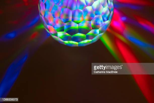 coloured light through a multi faceted crystal - catherine macbride stock pictures, royalty-free photos & images