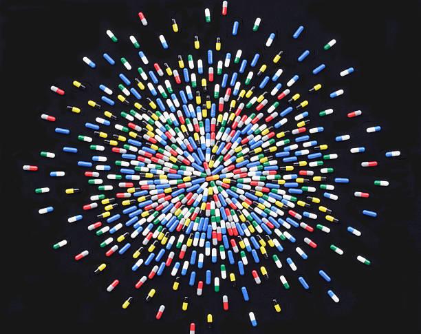 Coloured medicine capsules arranged in starburst pattern