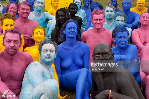 Coloured naked people pose for the camera shortly after taking part in a 850 strong naked installation for artist Spencer Tunick The atmosphere...