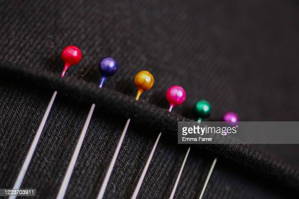 coloured needlework pins - needlecraft stock pictures, royalty-free photos & images