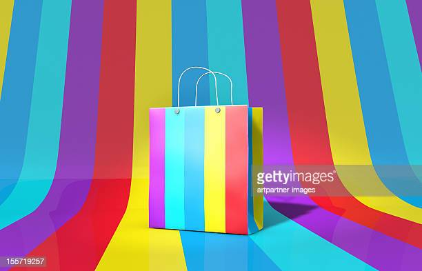 Coloured paper-bag on a multi-coloured background
