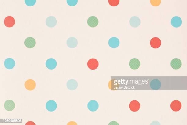 coloured polka dots - spotted stock-fotos und bilder