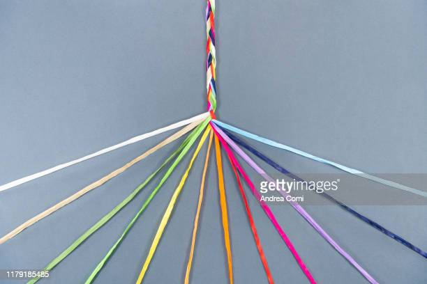coloured ropes knotting together - unity stock pictures, royalty-free photos & images