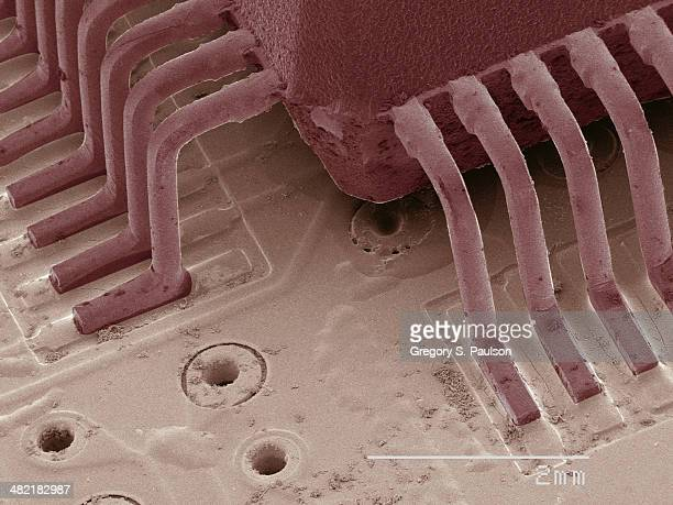 coloured sem of computer chip - sem stock pictures, royalty-free photos & images