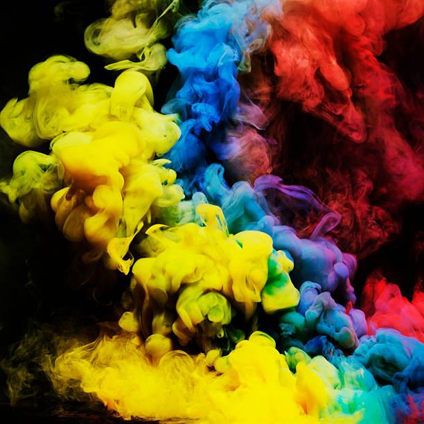 coloured smoke mixing in dark room