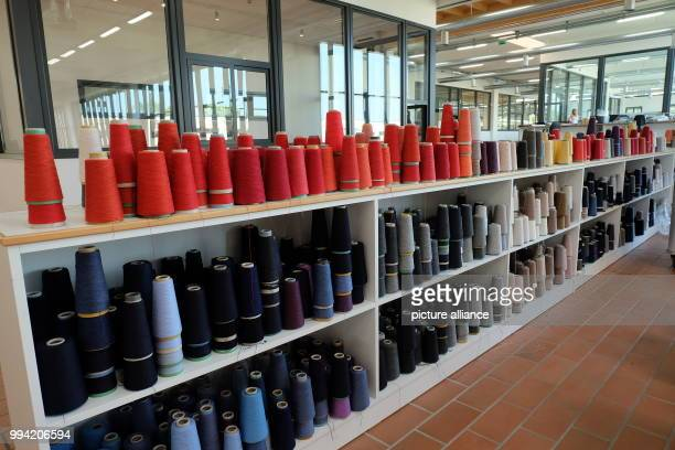 Coloured spools used to manufacture prototype models at the Brunello Cucinelli factory in Solomeo, Italy, 30 August 2017. Photo: Alivse Armellini/dpa