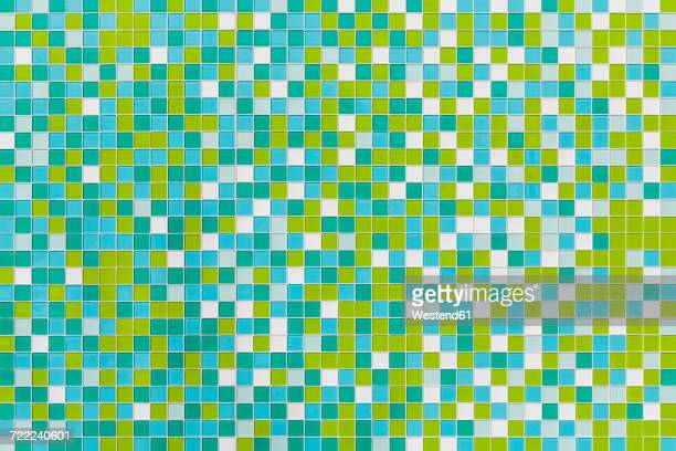 Coloured tiles made of glass