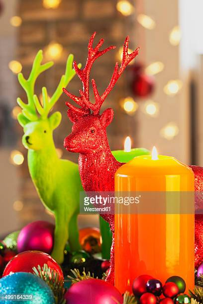 Colourful Advent wreath with candles and toy deers
